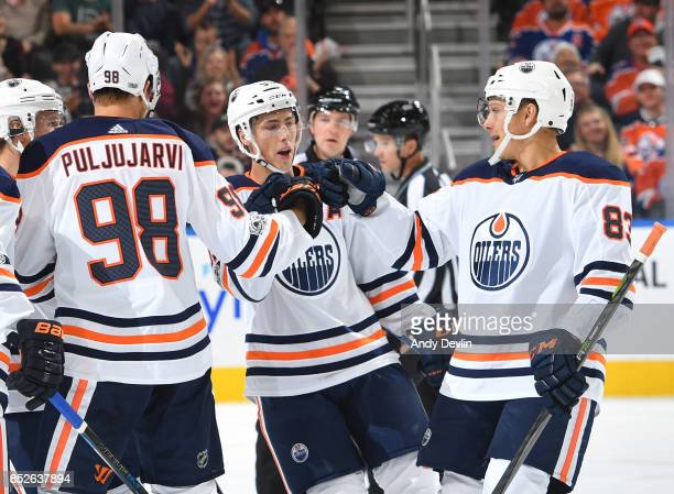 Ryan NugentHopkins Jesse Puljujarvi and Matthew Benning of the Edmonton Oilers celebrate after a goal during the preseason game against the Winnipeg...