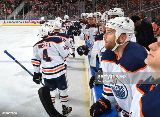 Ryan NugentHopkins Kris Russell and Matthew Benning of the Edmonton Oilers celebrate after a goal during the preseason game against the Winnipeg Jets...