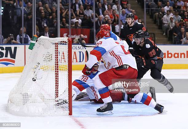 Ryan NugentHopkins of Team North America gets the puck past Sergei Bobrovsky of Team Russia to score a third period goal during the World Cup of...