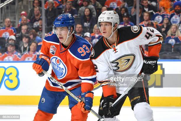 Ryan NugentHopkins of the Edmonton Oilers battles for position against Josh Manson of the Anaheim Ducks on April 1 2017 at Rogers Place in Edmonton...