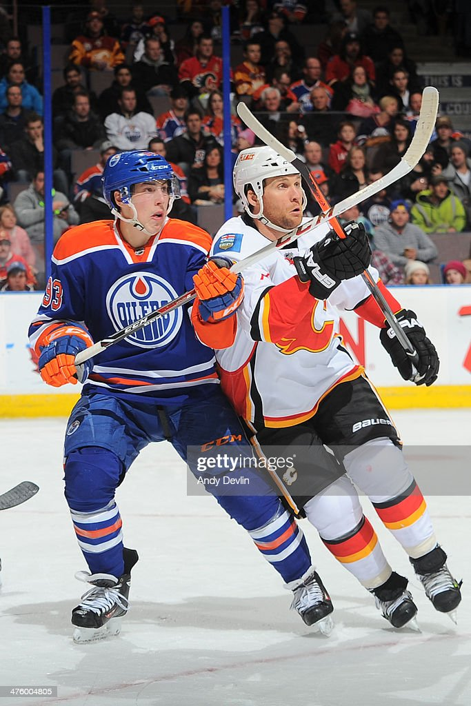 <a gi-track='captionPersonalityLinkClicked' href=/galleries/search?phrase=Ryan+Nugent-Hopkins&family=editorial&specificpeople=7144190 ng-click='$event.stopPropagation()'>Ryan Nugent-Hopkins</a> #93 of the Edmonton Oilers battles for position against <a gi-track='captionPersonalityLinkClicked' href=/galleries/search?phrase=Dennis+Wideman&family=editorial&specificpeople=575234 ng-click='$event.stopPropagation()'>Dennis Wideman</a> #6 of the Calgary Flames on March 1, 2014 at Rexall Place in Edmonton, Alberta, Canada.