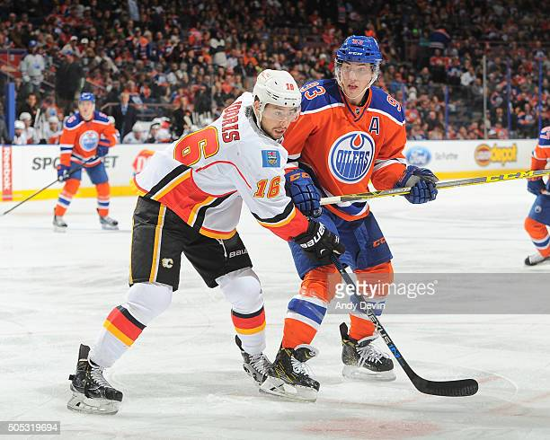Ryan NugentHopkins of the Edmonton Oilers battles position against Josh Jooris of the Calgary Flames on January 16 2016 at Rexall Place in Edmonton...