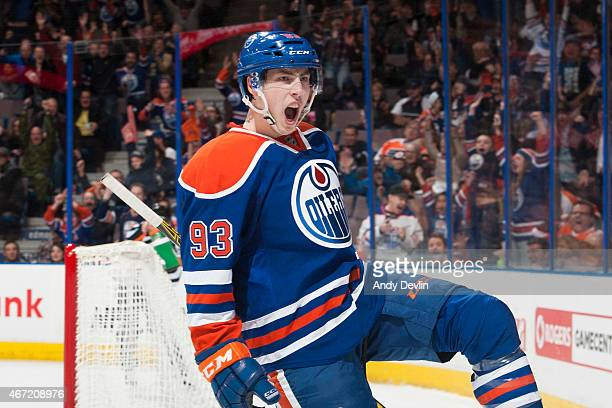 Ryan NugentHopkins of the Edmonton Oilers celebrates after scoring the game winning goal in overtime against the Philadelphia Flyers on March 21 2015...