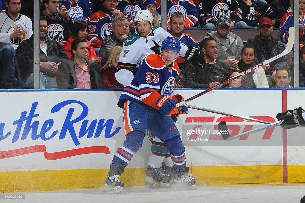 <a gi-track='captionPersonalityLinkClicked' href=/galleries/search?phrase=Ryan+Nugent-Hopkins&family=editorial&specificpeople=7144190 ng-click='$event.stopPropagation()'>Ryan Nugent-Hopkins</a> #93 of the Edmonton Oilers checks <a gi-track='captionPersonalityLinkClicked' href=/galleries/search?phrase=Brad+Stuart+-+Ice+Hockey+Player&family=editorial&specificpeople=213995 ng-click='$event.stopPropagation()'>Brad Stuart</a> #7 of the San Jose Sharks in first period action at Rexall Place on January 22, 2013 in Edmonton, Alberta, Canada.
