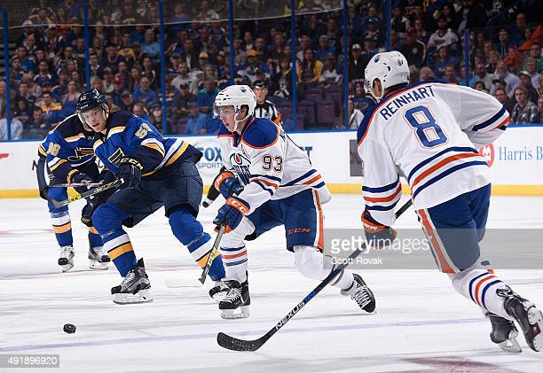 Ryan NugentHopkins of the Edmonton Oilers handles the puck as Colton Parayko of the St Louis Blues defends on October 8 2015 at Scottrade Center in...