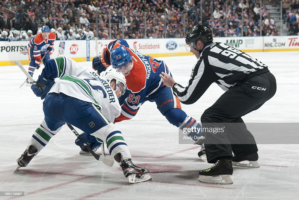 <a gi-track='captionPersonalityLinkClicked' href=/galleries/search?phrase=Ryan+Nugent-Hopkins&family=editorial&specificpeople=7144190 ng-click='$event.stopPropagation()'>Ryan Nugent-Hopkins</a> #93 of the Edmonton Oilers lines up for a face off against <a gi-track='captionPersonalityLinkClicked' href=/galleries/search?phrase=Jordan+Schroeder&family=editorial&specificpeople=4450940 ng-click='$event.stopPropagation()'>Jordan Schroeder</a> #45 of the Vancouver Canucks on March 30, 2013 at Rexall Place in Edmonton, Alberta, Canada.