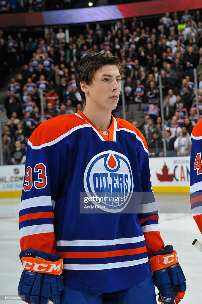 Ryan Nugent-Hopkins #93 of the Edmonton Oilers lines up for the singing of the national anthem in a game against the Los Angeles Kings at Rexall Place on January 24, 2013 in Edmonton, Alberta, Canada.
