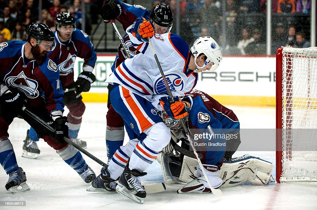 Ryan Nugent-Hopkins #93 of the Edmonton Oilers looks to put a loose puck past Semyon Varlamov #1 of the Colorado Avalanche as Greg Zanon #4 defends in the first period of a game at the Pepsi Center on February 2, 2013 in Denver, Colorado.