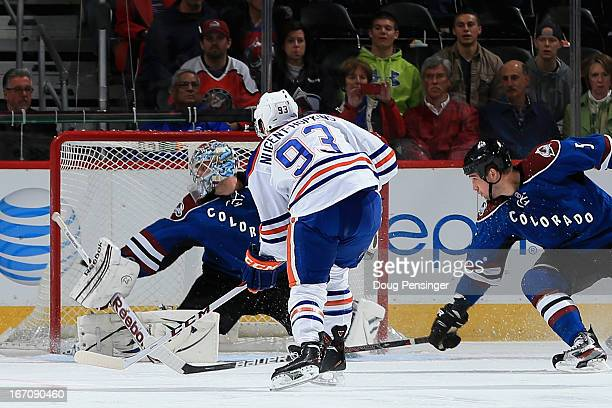 Ryan NugentHopkins of the Edmonton Oilers puts a shot past goalie Semyon Varlamov of the Colorado Avalanche and defenseman Shane O'Brien of the...