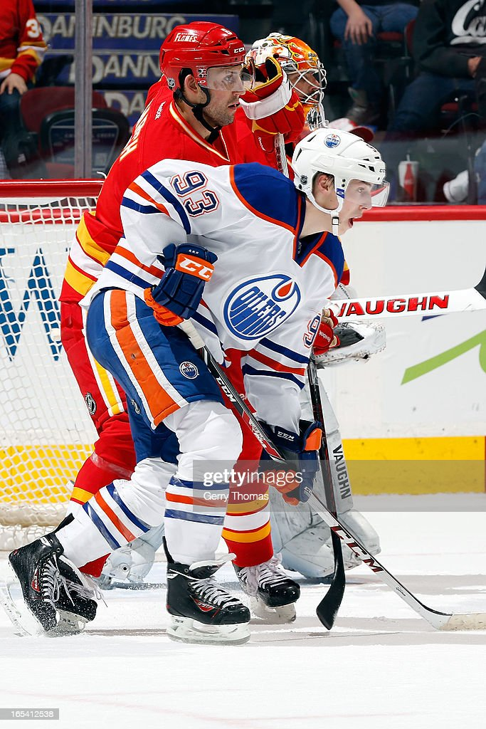 <a gi-track='captionPersonalityLinkClicked' href=/galleries/search?phrase=Ryan+Nugent-Hopkins&family=editorial&specificpeople=7144190 ng-click='$event.stopPropagation()'>Ryan Nugent-Hopkins</a> #93 of the Edmonton Oilers skates against <a gi-track='captionPersonalityLinkClicked' href=/galleries/search?phrase=Cory+Sarich&family=editorial&specificpeople=204153 ng-click='$event.stopPropagation()'>Cory Sarich</a> #6 of the Calgary Flames on April 3, 2013 at the Scotiabank Saddledome in Calgary, Alberta, Canada.