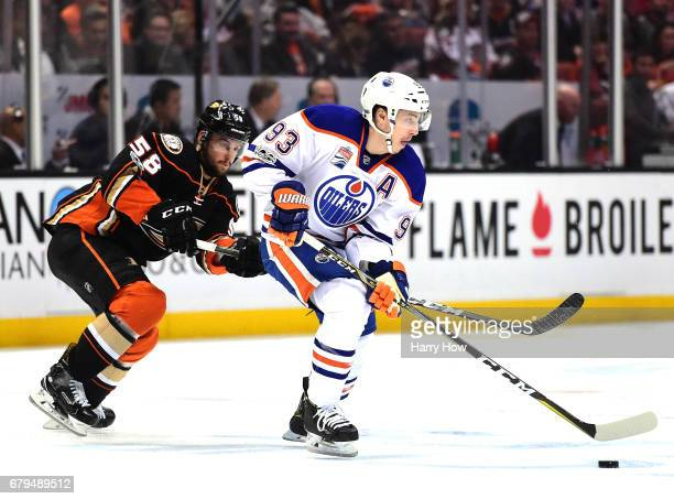 Ryan NugentHopkins of the Edmonton Oilers skates away from Nicolas Kerdiles of the Anaheim Ducks during the first period in Game Five of the Western...