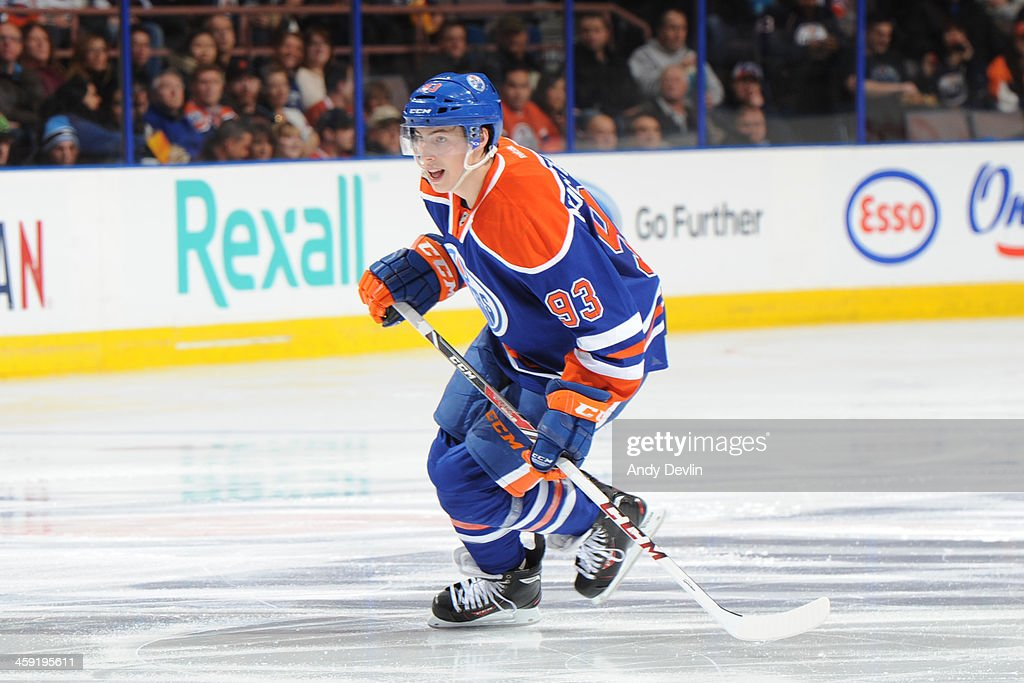 <a gi-track='captionPersonalityLinkClicked' href=/galleries/search?phrase=Ryan+Nugent-Hopkins&family=editorial&specificpeople=7144190 ng-click='$event.stopPropagation()'>Ryan Nugent-Hopkins</a> #93 of the Edmonton Oilers skates on the ice in a game against the Winnipeg Jets on December 23, 2013 at Rexall Place in Edmonton, Alberta, Canada.