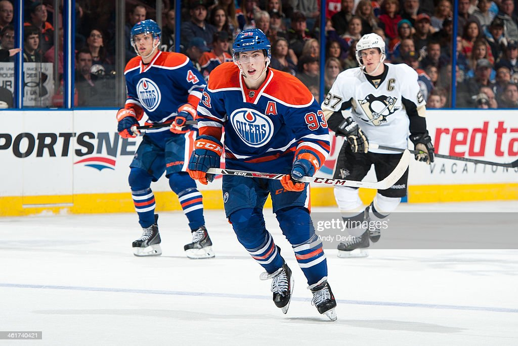 <a gi-track='captionPersonalityLinkClicked' href=/galleries/search?phrase=Ryan+Nugent-Hopkins&family=editorial&specificpeople=7144190 ng-click='$event.stopPropagation()'>Ryan Nugent-Hopkins</a> #93 of the Edmonton Oilers skates on the ice in a game against the Pittsburgh Penguins on January 10, 2014 at Rexall Place in Edmonton, Alberta, Canada.