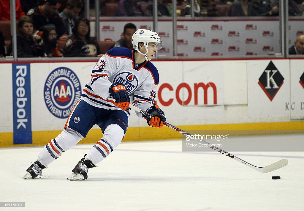 <a gi-track='captionPersonalityLinkClicked' href=/galleries/search?phrase=Ryan+Nugent-Hopkins&family=editorial&specificpeople=7144190 ng-click='$event.stopPropagation()'>Ryan Nugent-Hopkins</a> #93 of the Edmonton Oilers stickhandles the puck in the neutral zone against the Anaheim Ducks during the NHL game at Honda Center on April 8, 2013 in Anaheim, California. The Ducks defeated the Oilers 2-1.