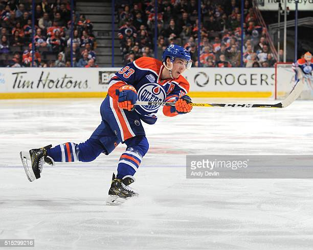 Ryan NugentHopkins of the Edmonton Oilers takes a shot during a game against the Arizona Coyotes on March 12 2016 at Rexall Place in Edmonton Alberta...