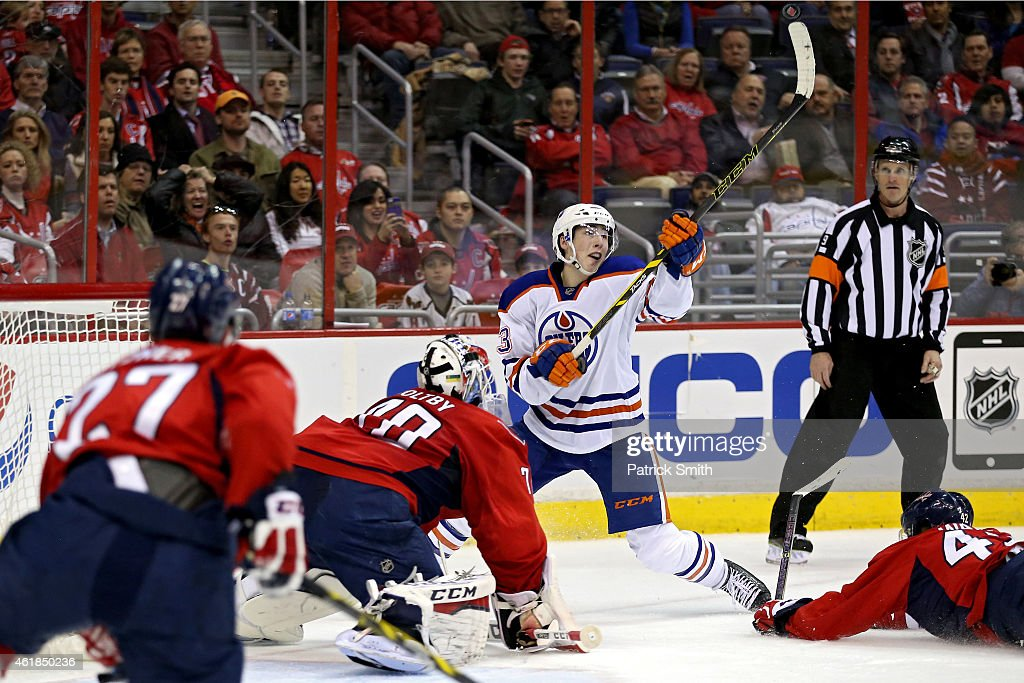 Ryan Nugent-Hopkins #93 of the Edmonton Oilers tries to shoot as the puck bounces into the air on goalie Braden Holtby #70 of the Washington Capitals in the second period at Verizon Center on January 20, 2015 in Washington, DC.