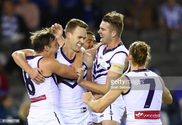 Ryan Nyhuis of the Dockers is congratulated by his teammates after kicking his first goal in the AFL during the round 16 AFL match between the North...