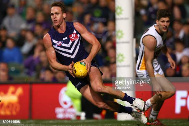 Ryan Nyhuis of the Dockers looks to pass the ball during the round 18 AFL match between the Fremantle Dockers and the Hawthorn Hawks at Domain...