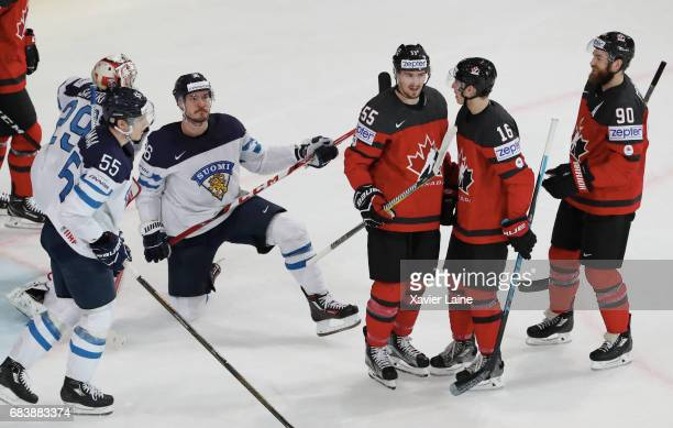 Ryan O Reilly Mitch Marner and Mark Scheifele of Canada celebrate a goal and Atte Ohtamaa and Miko Rantanen of Finland are disapointed during the...