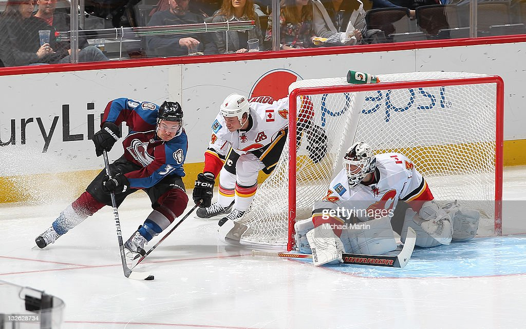 Ryan O'Byrne of the Colorado Avalanche skates around the goal against Jay Bouwmeester of the Calgary Flames at the Pepsi Center on November 12 2011...