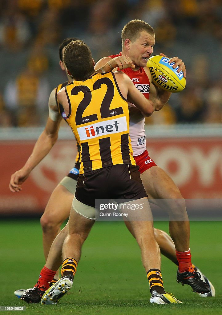 <a gi-track='captionPersonalityLinkClicked' href=/galleries/search?phrase=Ryan+O%27Keefe&family=editorial&specificpeople=214559 ng-click='$event.stopPropagation()'>Ryan O'Keefe</a> of the Swans is tackled by Luke Breust of the Hawks during the round seven AFL match between the Hawthorn Hawks and the Sydney Swans at Melbourne Cricket Ground on May 11, 2013 in Melbourne, Australia.