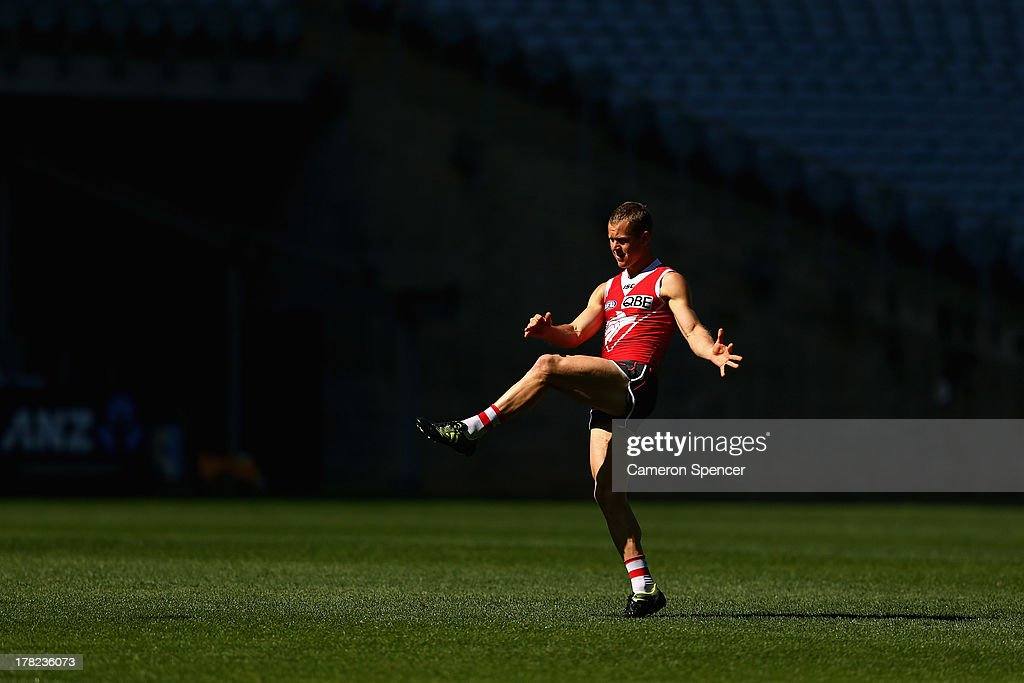 Ryan O'Keefe of the Swans kicks during a Sydney Swans AFL training session at ANZ Stadium on August 28, 2013 in Sydney, Australia.