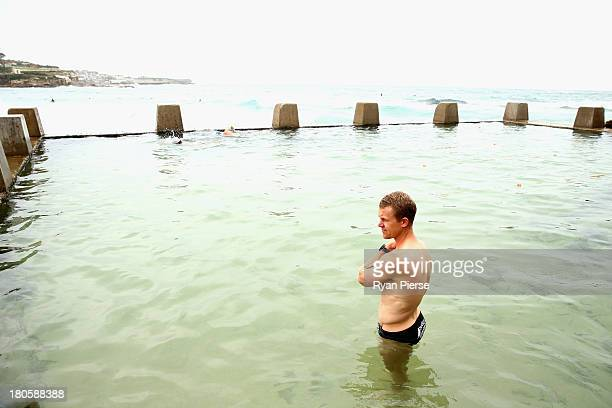 Ryan O'Keefe of the Swans swims during a recovery session at Coogee Beach on September 15 2013 in Sydney Australia
