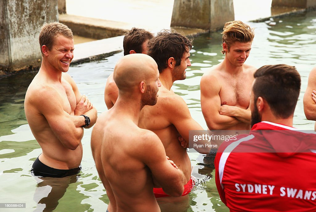 Ryan O'Keefe (L) of the Swans swims during a recovery session at Coogee Beach on September 15, 2013 in Sydney, Australia.