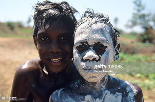 Ryan on left Didi on right who has covered his face with beautiful natural white clay which can be found in some streams close to where they enter...