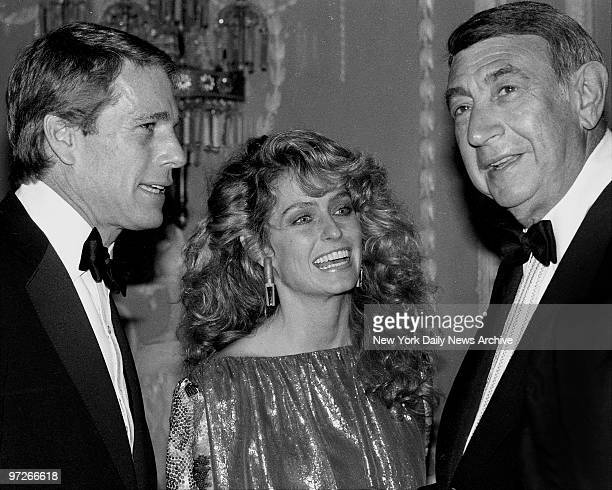 Ryan O'Neal Farrah Fawcett and Howard Cosell at WaldorfAstoria where the Friars Club honored Cary Grant as their Man of the Year