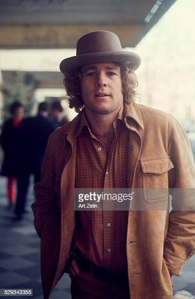 Ryan O'Neal in a hat and suede jacket circa 1980 New York