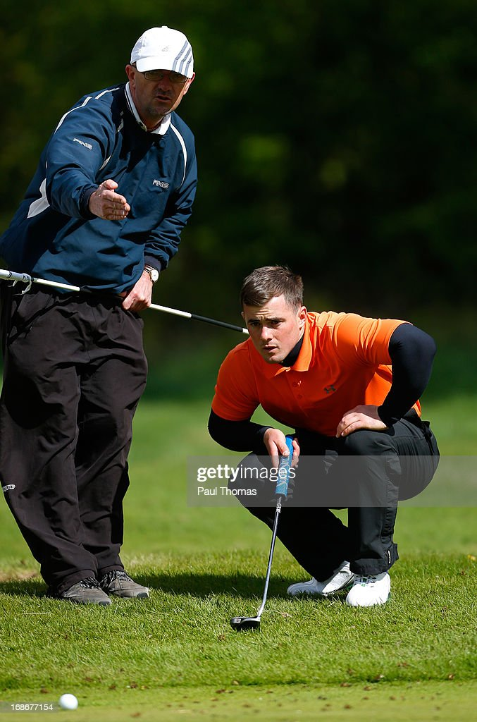 Ryan O'Neill (R) of Penwortham Golf Club lines up a putt with the help of his caddie on 17th hole during the Glenmuir PGA Professional Championship North East Regional Qualifier at Fulford Golf Club on May 13, 2013 in York, England.