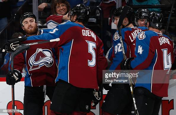 Ryan O'Reilly of the Colorado Avalanche celebrates his goal against the Calgary Flames with teammates Nate Guenin Gabriel Landeskog Alex Tanguay and...
