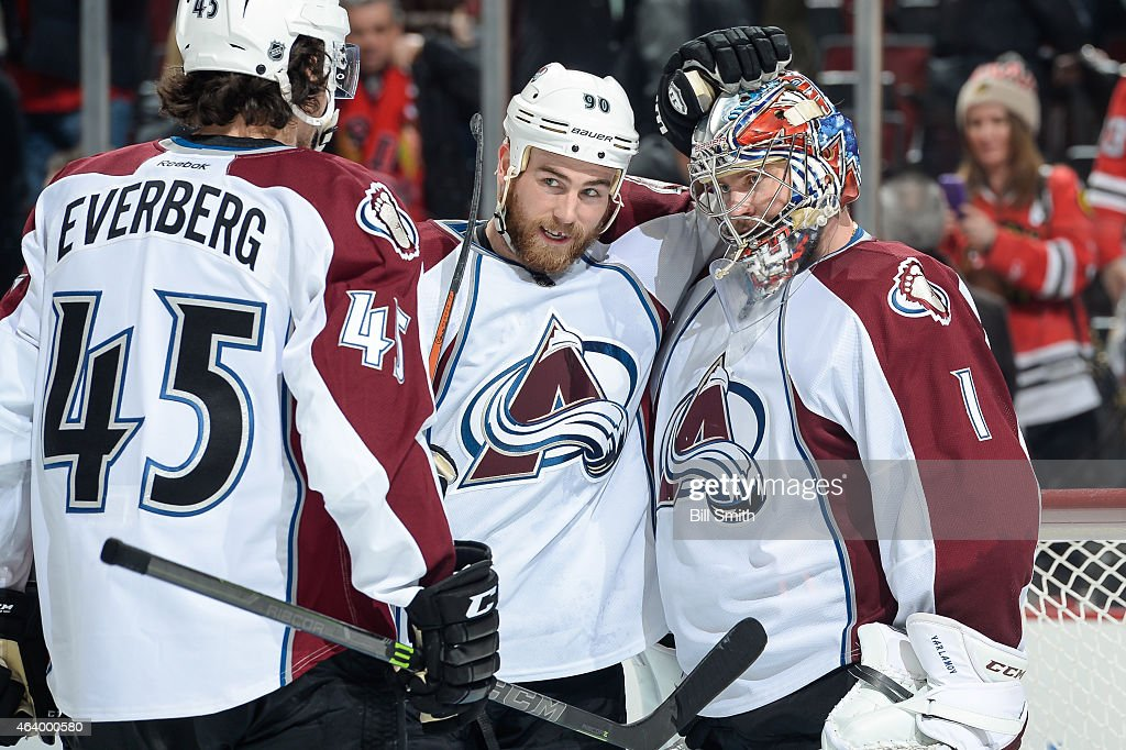 Ryan O'Reilly #90 and goalie Semyon Varlamov #1 of the Colorado Avalanche celebrate after defeating the Chicago Blackhawks 4-1 during the NHL game at the United Center on February 20, 2015 in Chicago, Illinois.