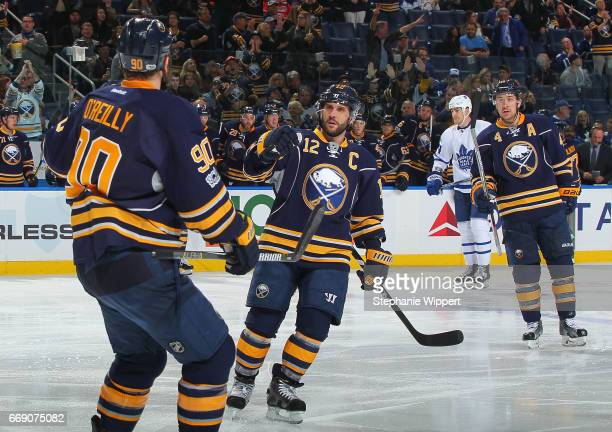 Ryan O'Reilly Brian Gionta an Josh Gorges of the Buffalo Sabres celebrate a goal during an NHL game against the Toronto Maple Leafs at the KeyBank...