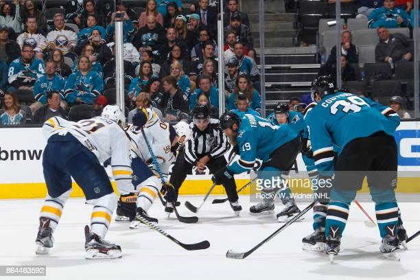 Ryan O'Reilly of the Buffalo Sabres and Joe Thornton of the San Jose Sharks faceoff at SAP Center on October 12 2017 in San Jose California