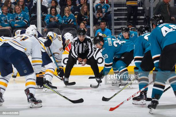 Ryan O'Reilly of the Buffalo Sabres and Logan Couture of the San Jose Sharks faceoff at SAP Center on October 12 2017 in San Jose California