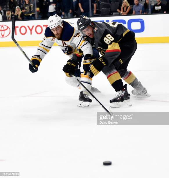Ryan O'Reilly of the Buffalo Sabres and Nate Schmidt of the Vegas Golden Knights vie for the puck at TMobile Arena on October 17 2017 in Las Vegas...