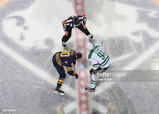 Ryan O'Reilly of the Buffalo Sabres and Tyler Seguin of the Dallas Stars battle for the opening faceoff during an NHL game on November 17 2015 at the...