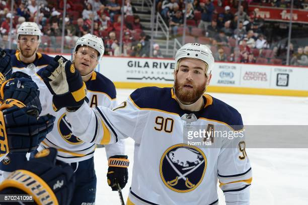 Ryan O'Reilly of the Buffalo Sabres celebrates a goal with teammates on the bench against the Arizona Coyotes at Gila River Arena on November 2 2017...