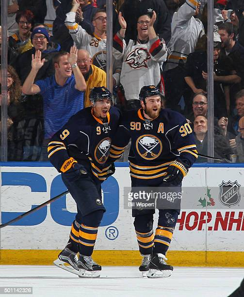 Ryan O'Reilly of the Buffalo Sabres celebrates his game winning overtime goal with Evander Kane against the Los Angeles Kings during an NHL game on...
