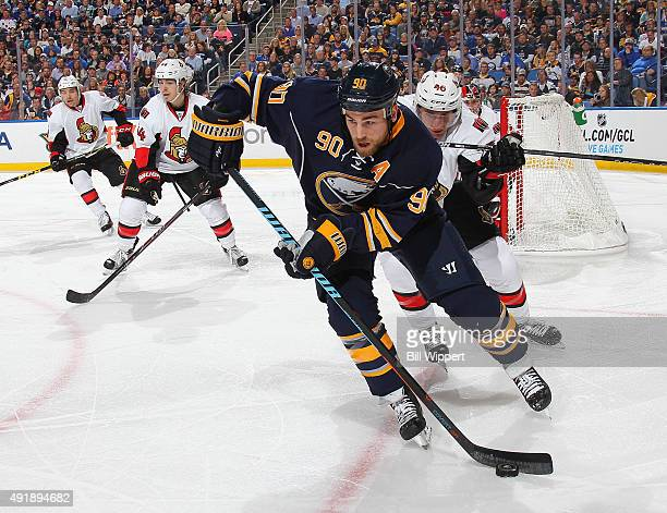 Ryan O'Reilly of the Buffalo Sabres controls the puck against Patrick Wiercioch of the Ottawa Senators on October 8 2015 at the First Niagara Center...