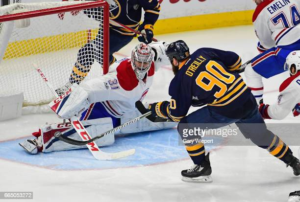 Ryan O'Reilly of the Buffalo Sabres is stopped by Carey Price of the Montreal Canadiens during an NHL game at the KeyBank Center on April 5 2017 in...
