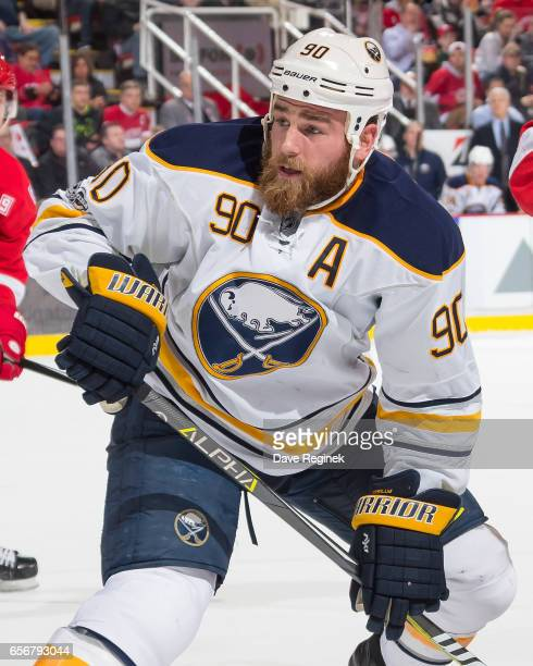 Ryan O'Reilly of the Buffalo Sabres looks for the puck after the face off against the Detroit Red Wings during an NHL game at Joe Louis Arena on...