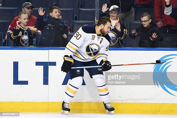 Ryan O'Reilly of the Buffalo Sabres picks up a puck with his stick during warmups during the game against the Detroit Red Wings on Friday January 22...