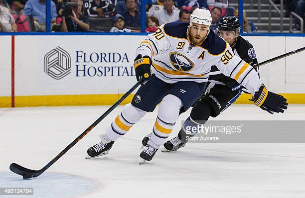 Ryan O'Reilly of the Buffalo Sabres races with the puck against Steven Stamkos of the Tampa Bay Lightning during the first period at the Amalie Arena...