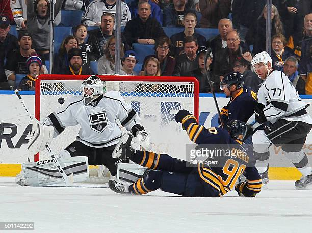 Ryan O'Reilly of the Buffalo Sabres scores the game winning overtime goal while falling to the ice against Jhonas Enroth of the Los Angeles Kings...