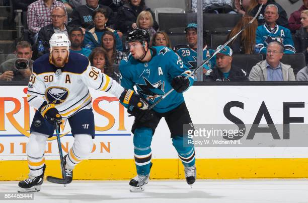 Ryan O'Reilly of the Buffalo Sabres skates against Logan Couture of the San Jose Sharks at SAP Center on October 12 2017 in San Jose California