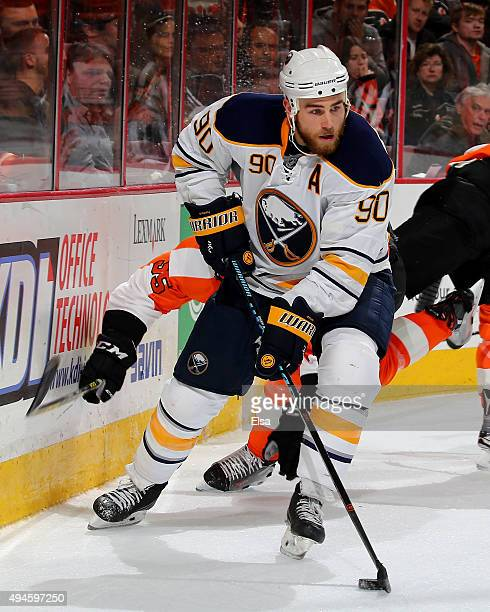 Ryan O'Reilly of the Buffalo Sabres wraps around the net as Nick Schultz of the Philadelphia Flyers defends on October 27 2015 at the Wells Fargo...