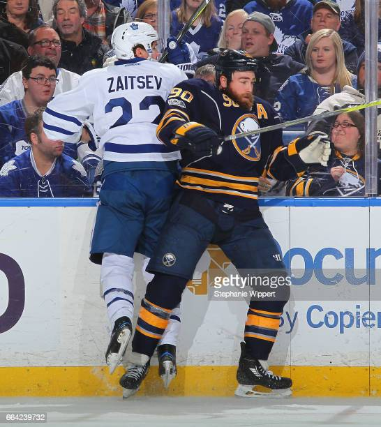 Ryan O'Reilly of the Buffalo Sabreschecks Nikita Zaitsev of the Toronto Maple Leafs during an NHL game at the KeyBank Center on April 3 2017 in...